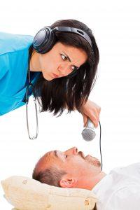 Doctor conducting sleep study