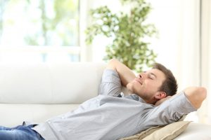 man resting on the sofa
