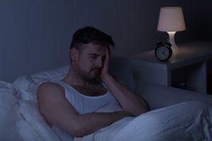 man lying awake