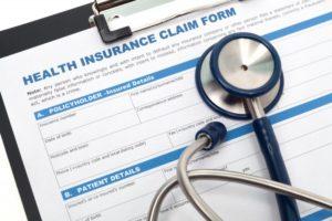 stethoscope on insurance claim form