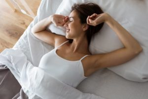 Woman waking up after enjoying the stages of sleep in Wesley Chapel